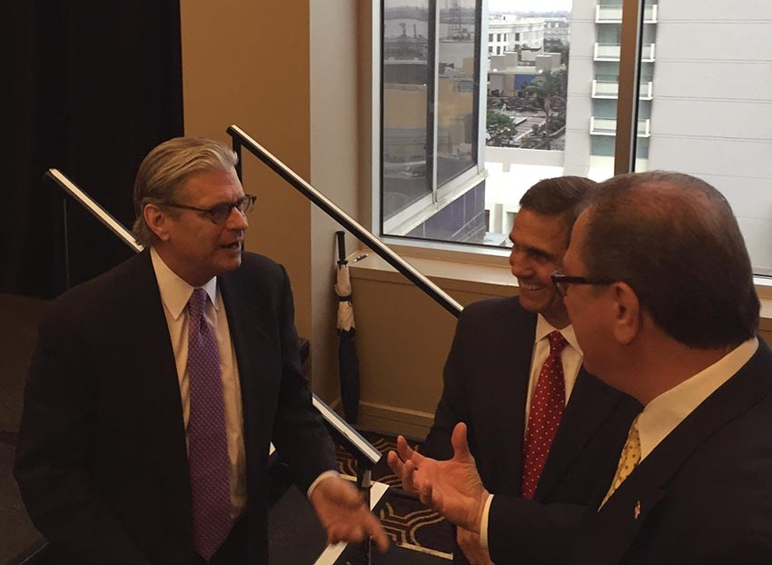 Jefferson Parish District Attorney Paul Connick Jr., left, speaks with New Orleans District Attorney Leon Cannizzaro, center, and investigator Capt. Kevin Smith during the 2016 Metropolitan Crime Commission awards ceremony on Tuesday, Feb. 23. (JPDA photo)